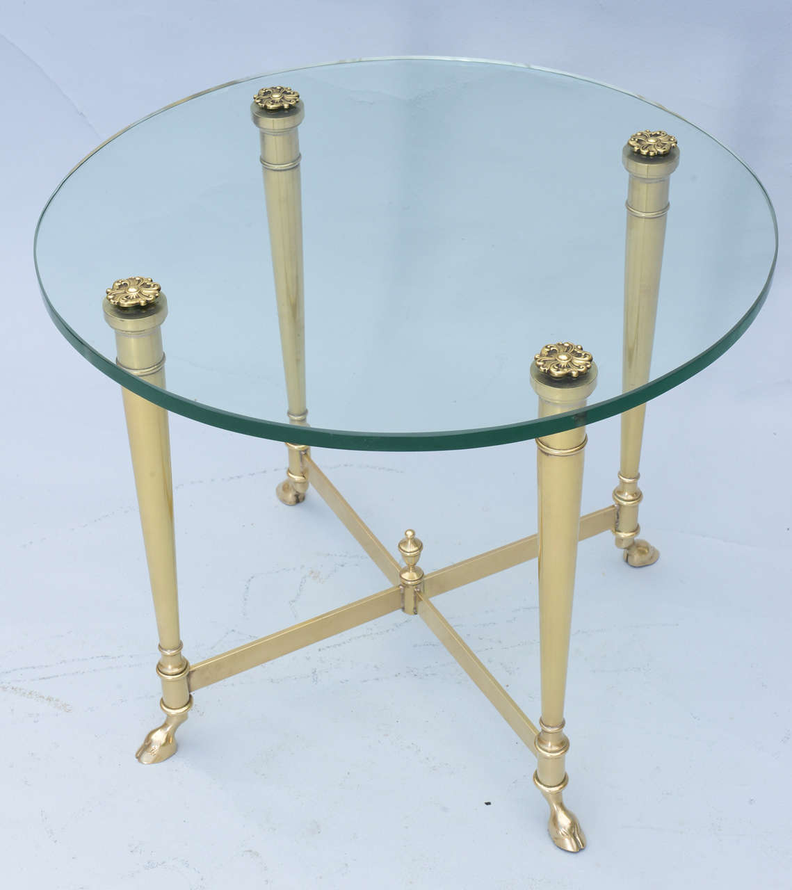 Polished brass end table with glass top on hoffed feet for Table 52 west palm beach